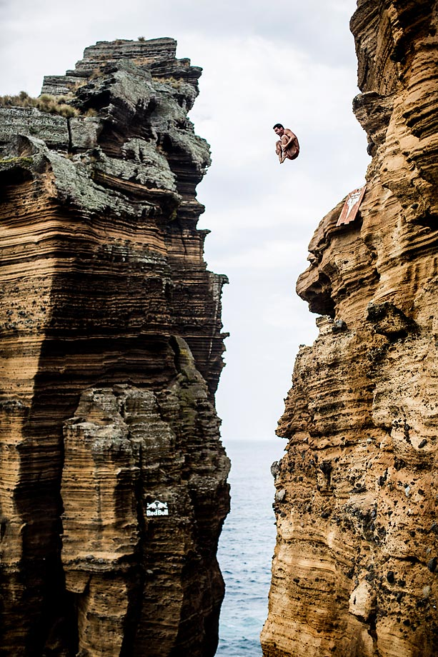 Steven LoBue dives from the 27-meter cliff during the Red Bull Cliff Diving World Series in Islet Franca do Campo, Azores, Portugal.