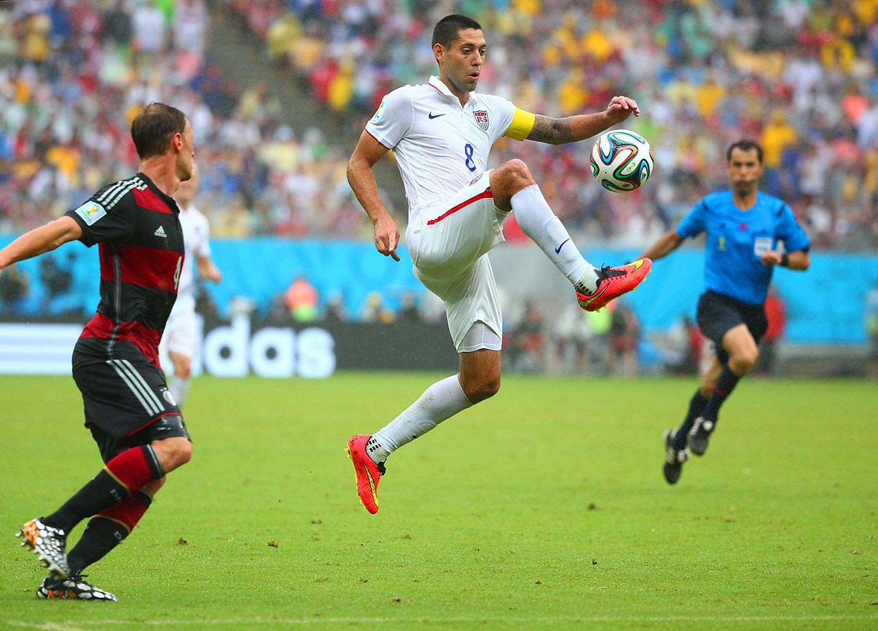 U.S. forward Clint Dempsey controls the ball during the the USMNT's third and final group stage match against Germany as defender Benedikt Höwedes looks on at Arena Pernambuco in Recife, Brazil.