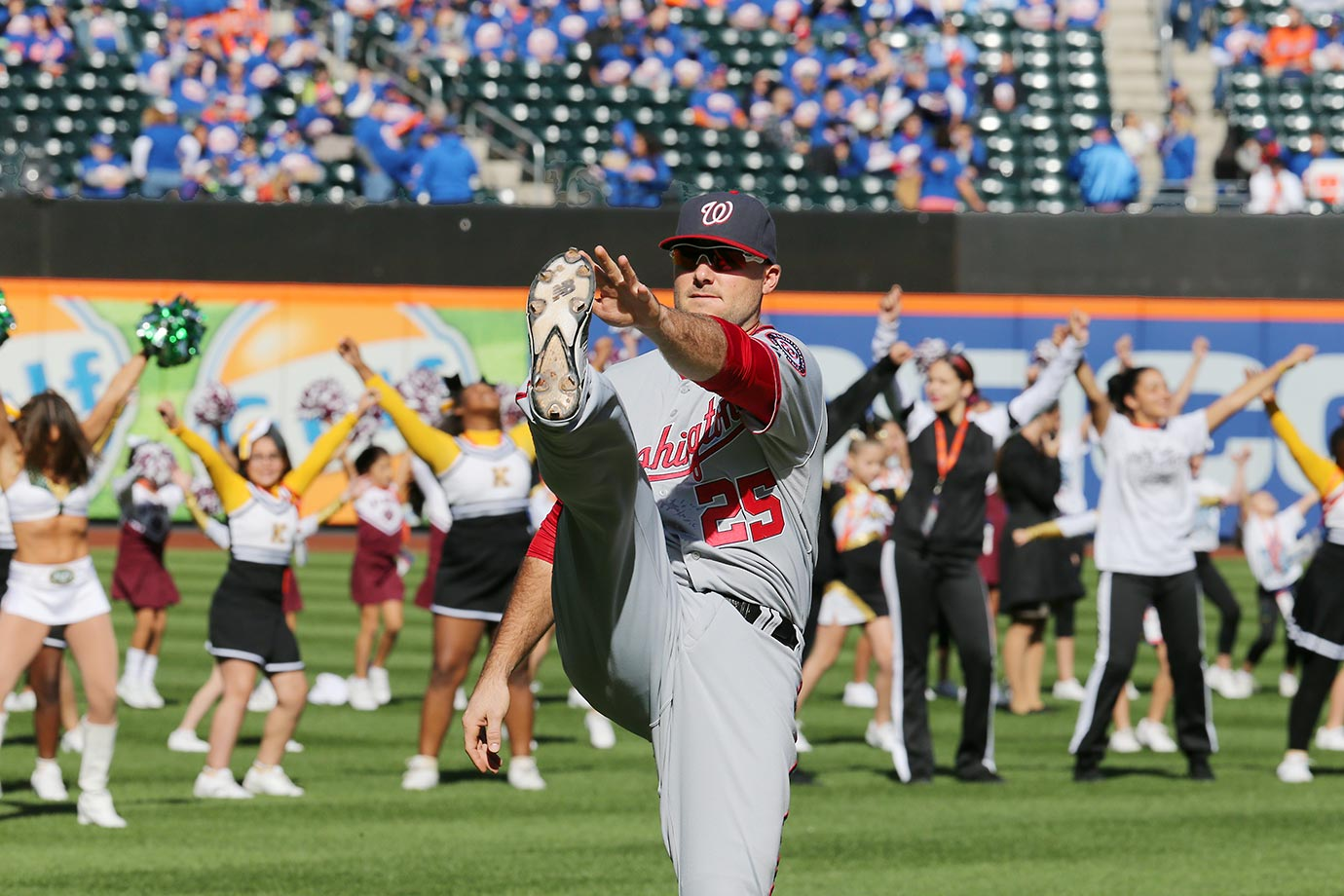 Clint Robinson of the Washington Nationals does a little pre-game stretching before a game.  The New York Jets Flight Crew held a special event with young cheerleaders from the Metro area at Citi Field.