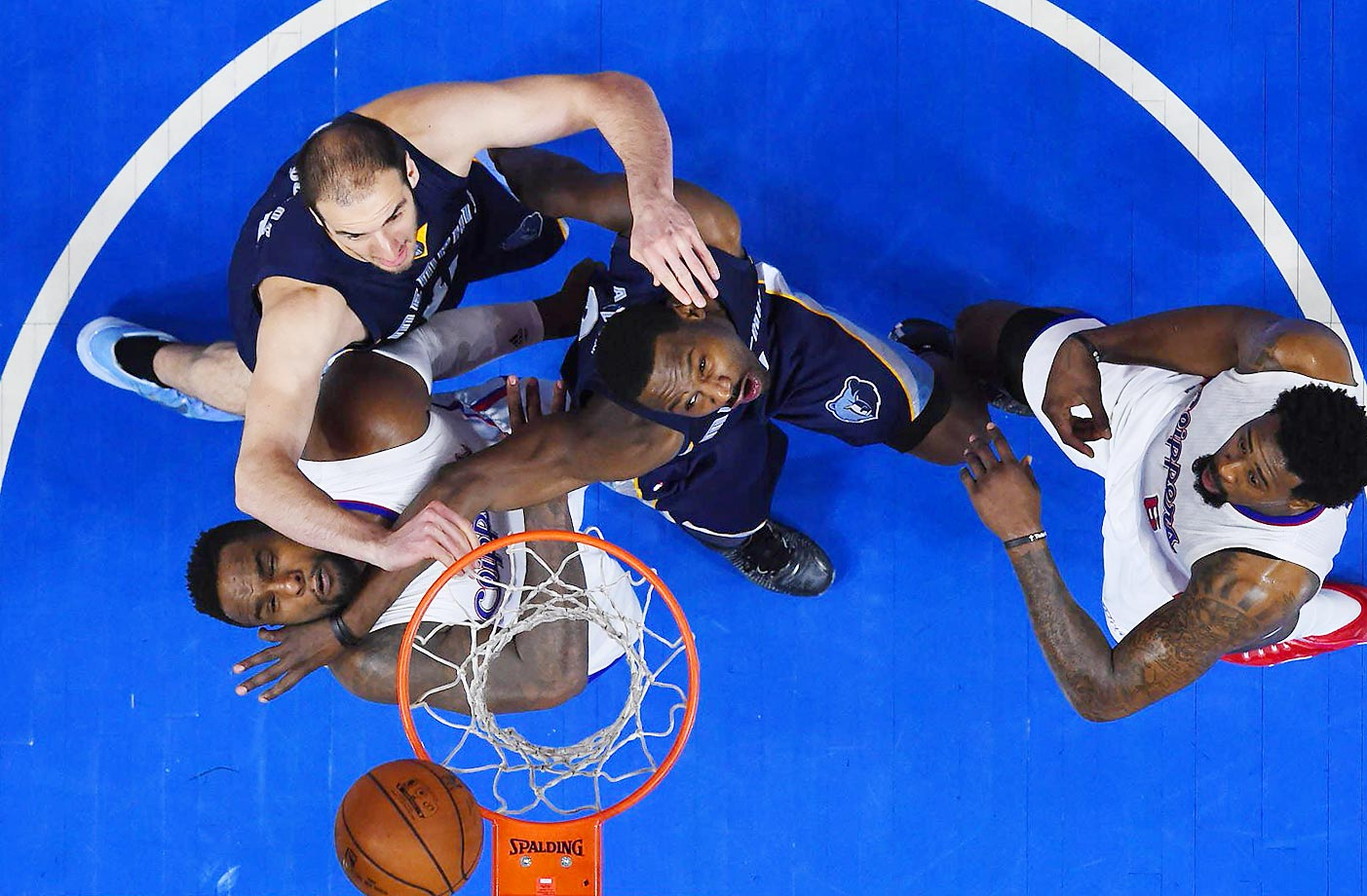 Players from the Los Angeles Clippers and Memphis Grizzlies fight for a rebound during a game at Staples Center.