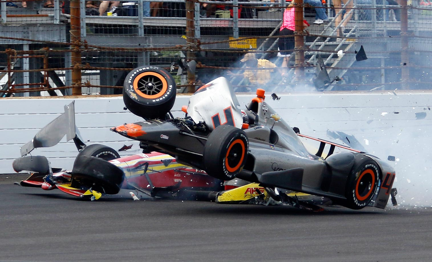 Stefano Coletti, top, hits the car driven by Sebastian Saavedra in the closing laps of the Indianapolis 500.