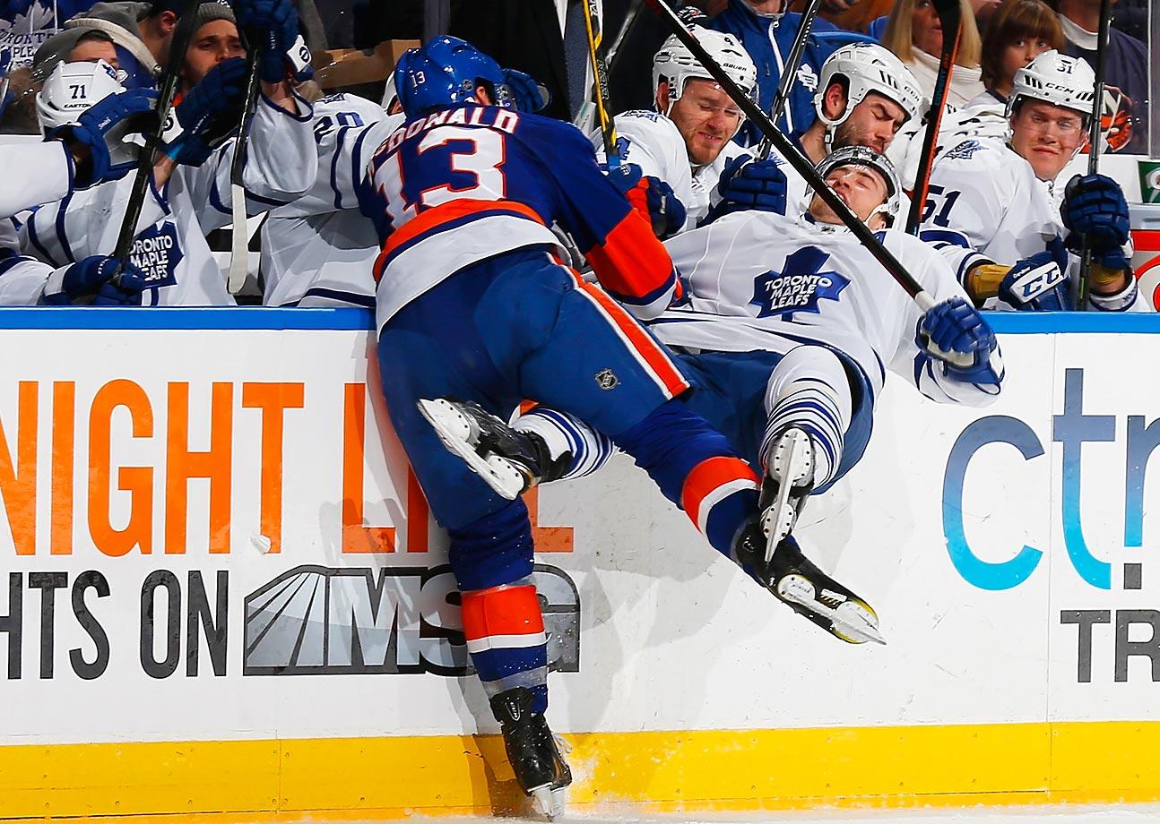 Colin McDonald (13) of the New York Islanders checks Stephane Robidas of the Toronto Maple Leafs.