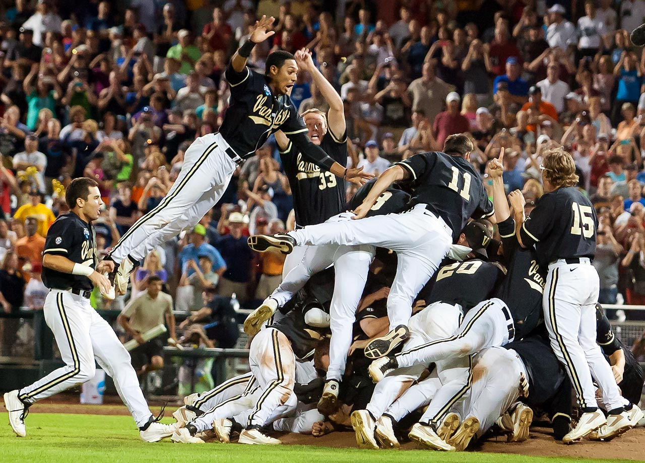 The Vanderbilt Commodores dogpile after beating Virginia 3-2 to win the College World Series at TD Ameritrade Park in Omaha, Neb.  The national championship was Vanderbilt's first in any sport.