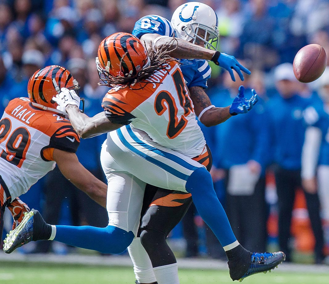 Adam Jones makes a hit on intended Colts receiver Reggie Wayne. The Bengals were shut out 27-0.