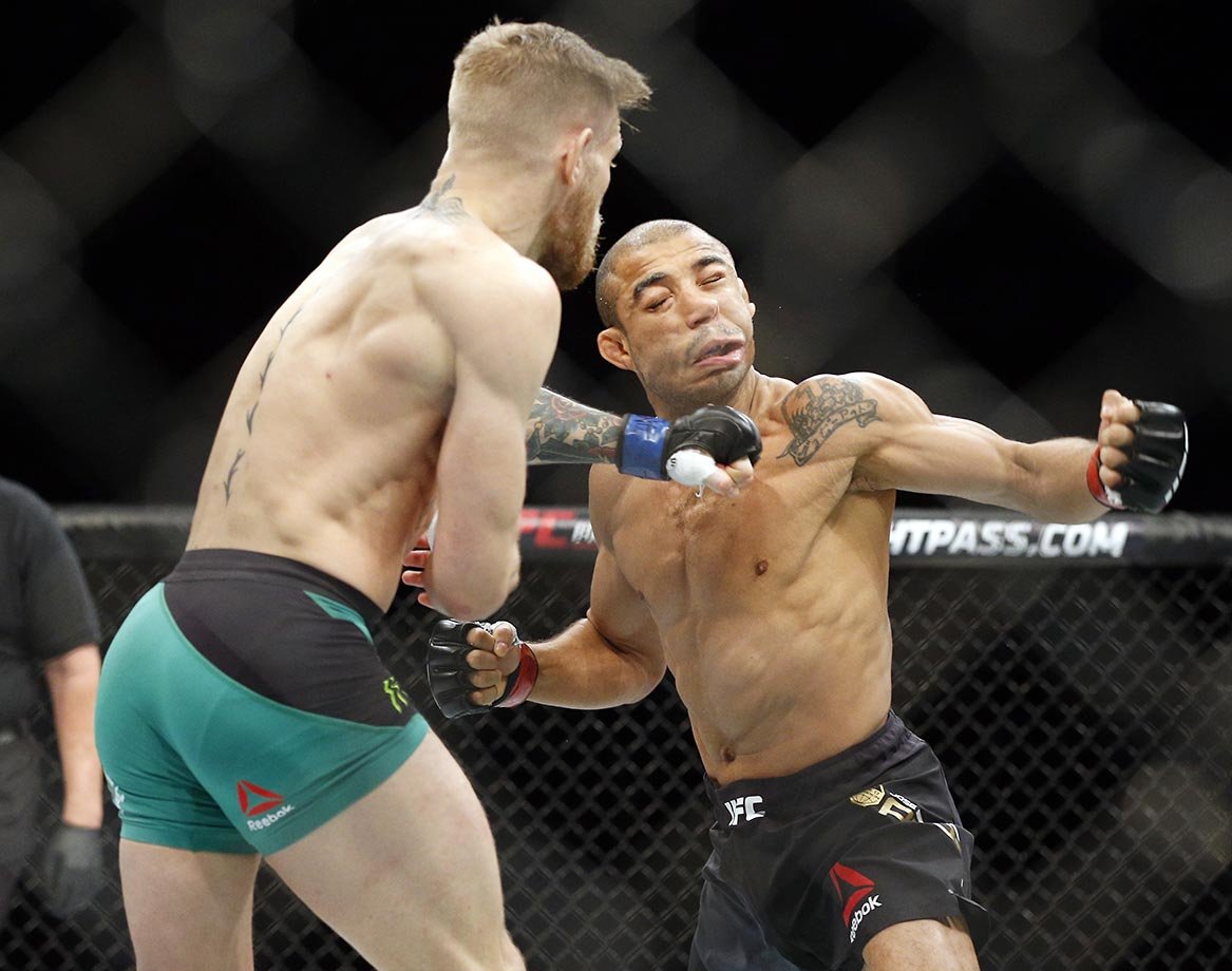 Conor McGregor knocks out  Jose Aldo during a featherweight championship bout at UFC 194.
