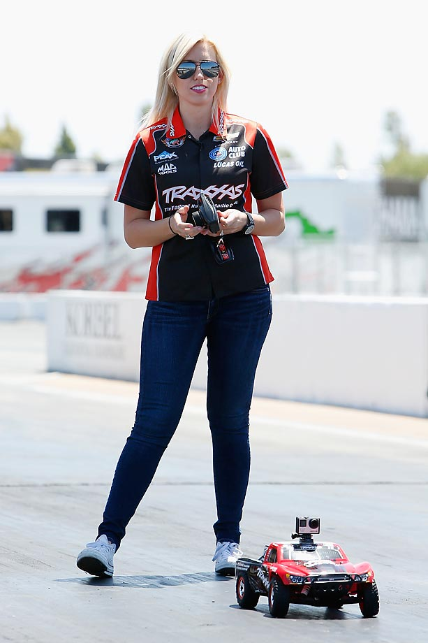 NHRA driver Courtney Force plays around on the Sonoma racetrack with a remote controlled car.