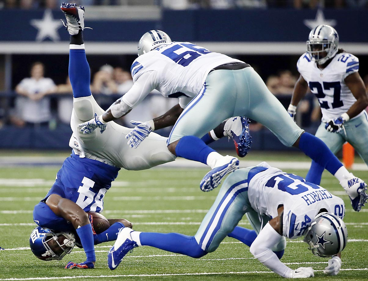 Giants tight end Larry Donnell is upended by Cowboys Rolando McClain and Barry Church.