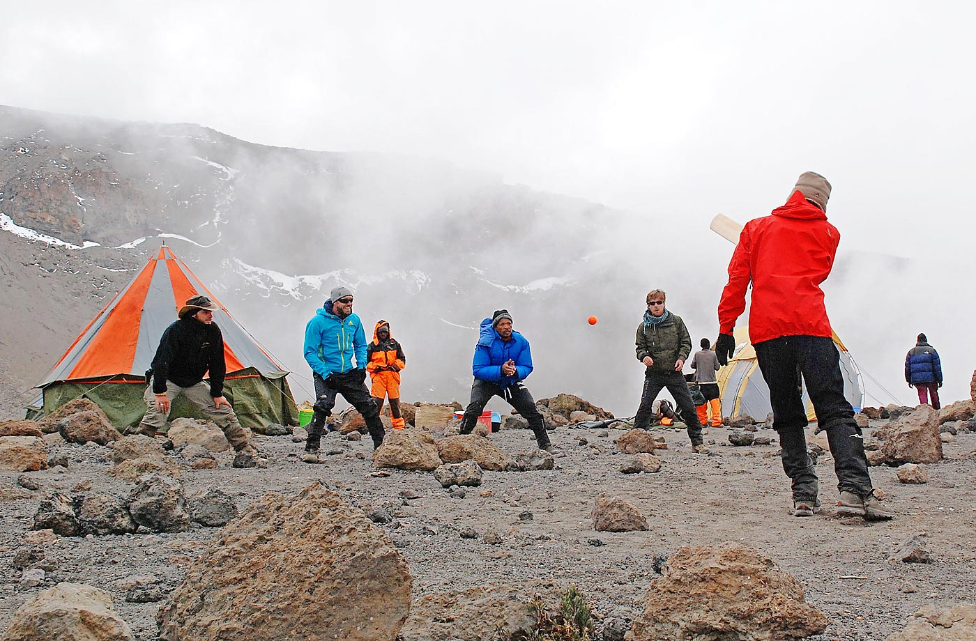 Cricketers practice on the ice-covered crater of the Kilimanjaro mountain, Tanzania. The game was an attempt to play the world's highest game of cricket, breaking the previous record set in 2009 on Mount Everest.