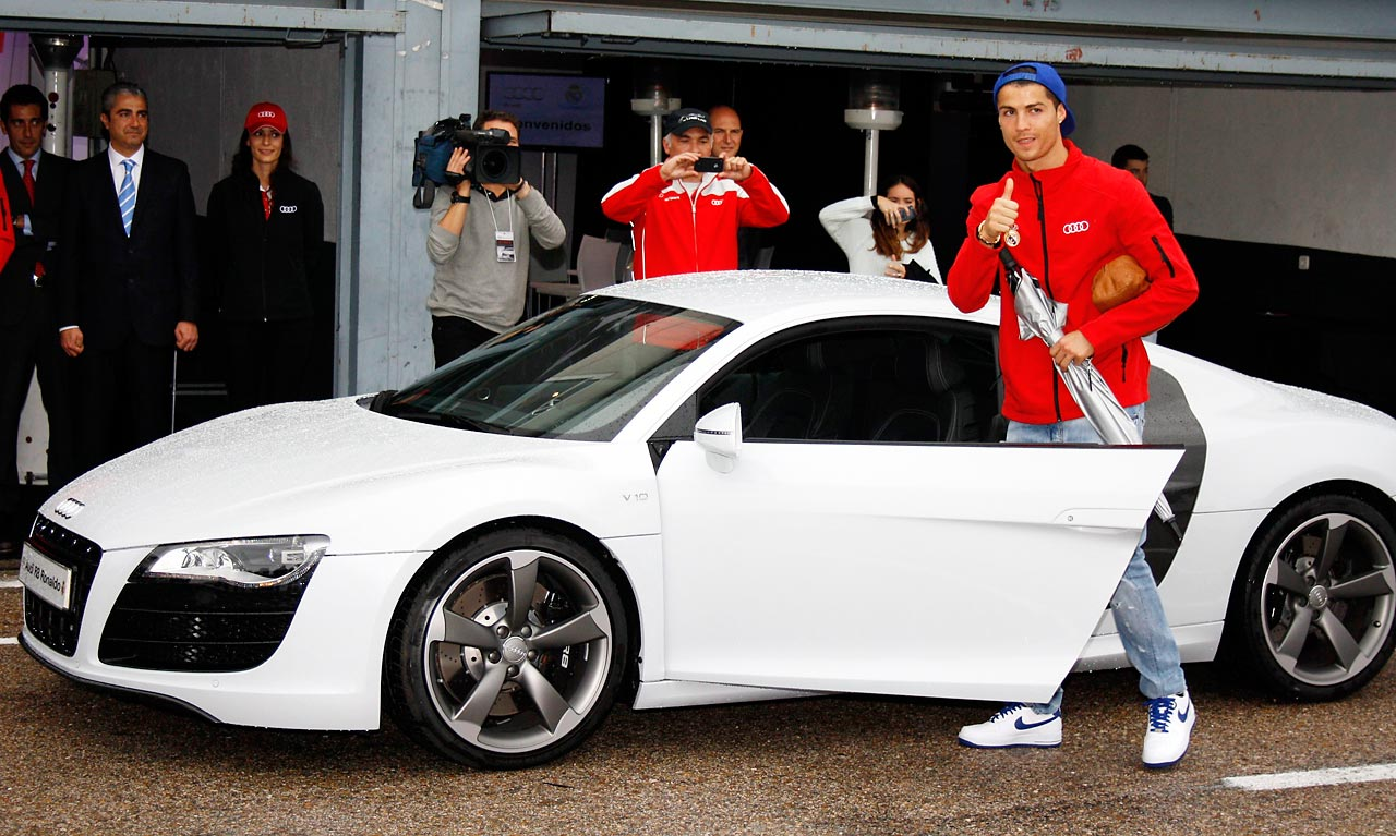 Real Madrid player Cristiano Ronaldo getting in his striking white Audi.