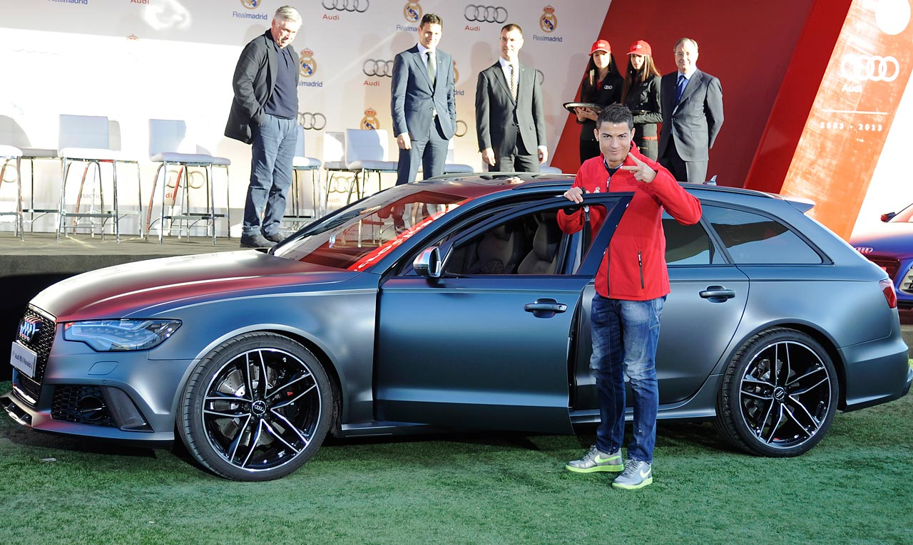 Real Madrid superstar Cristiano Ronaldo receives the keys to this shiny silver Audi.