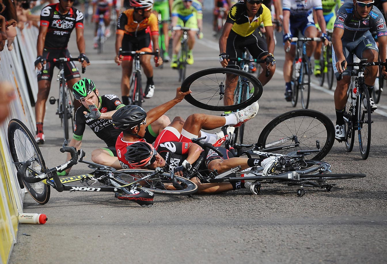 Cyclists pile up moments after finishing stage 6 of the 2015 Le Tour de Langkawi from Maran to Karak.
