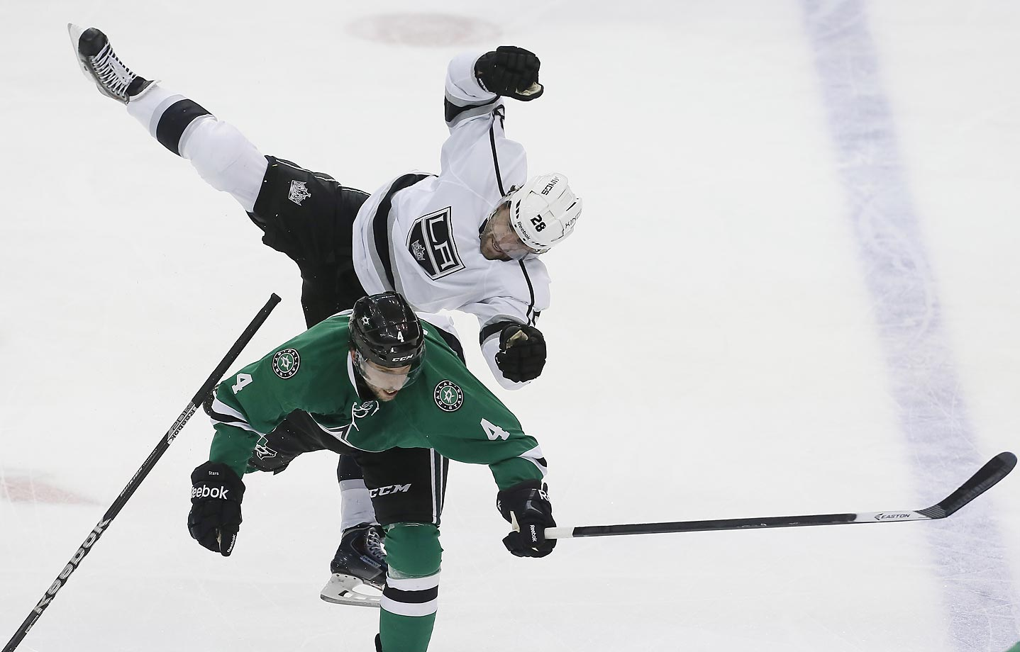Dallas Stars Jason Demers checks Kings Jarret Stoll on Sunday.