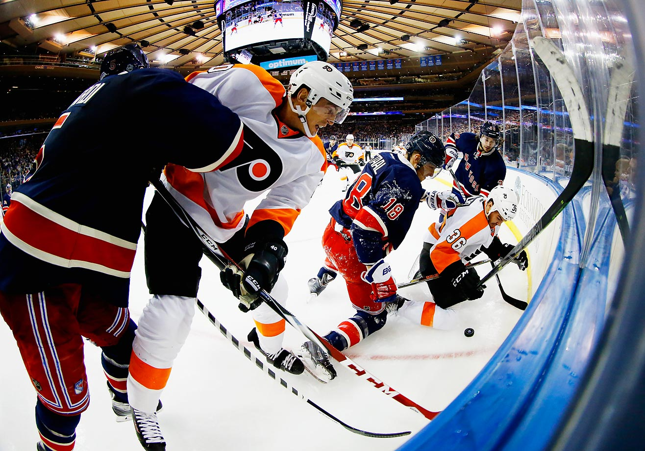 Dan Girardi, Marc Staal and Mats Zuccarello of the New York Rangers battle Vincent Lecavalier and Zac Rinaldo of the Philadelphia Flyers during their game at Madison Square Garden.