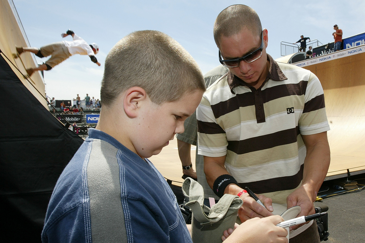Dave Mirra signs an autograph for a fan at Randalls Island.