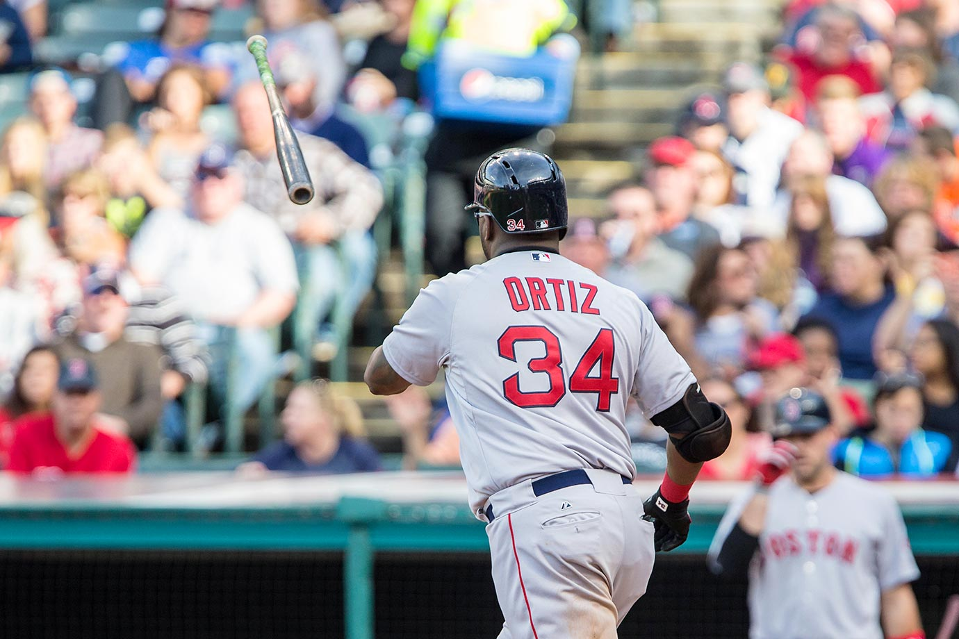 David Ortiz of the Boston Red Sox flips his bat toward the dugout after drawing a walk against the Cleveland Indians.