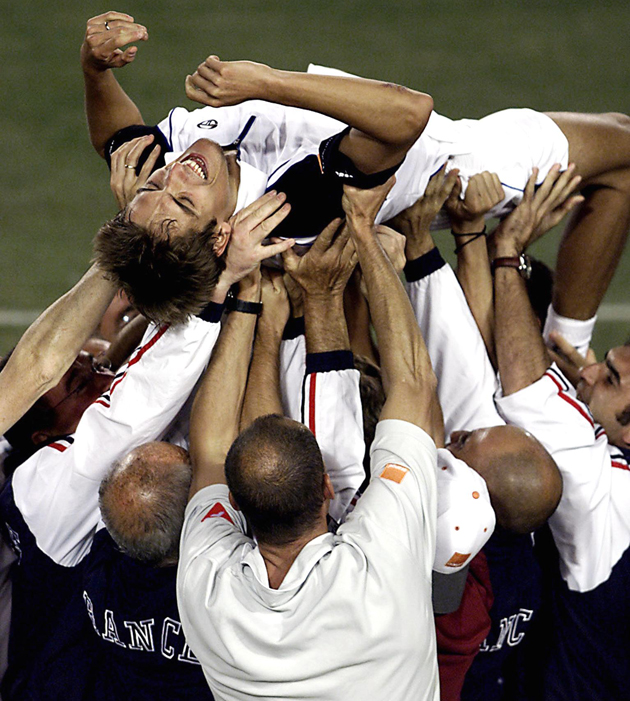 Escude is held aloft by teammates after defeating Wayne Arthurs of Australia to win the Davis Cup final.