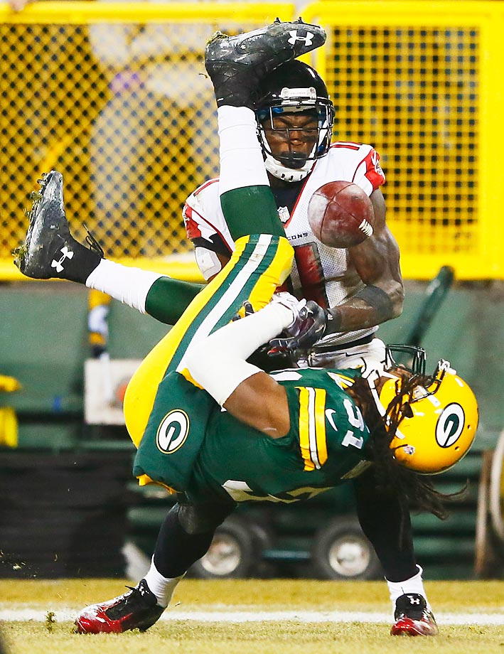Davon House of the Packers breaks up a pass intended for  Julio Jones of the Falcons.