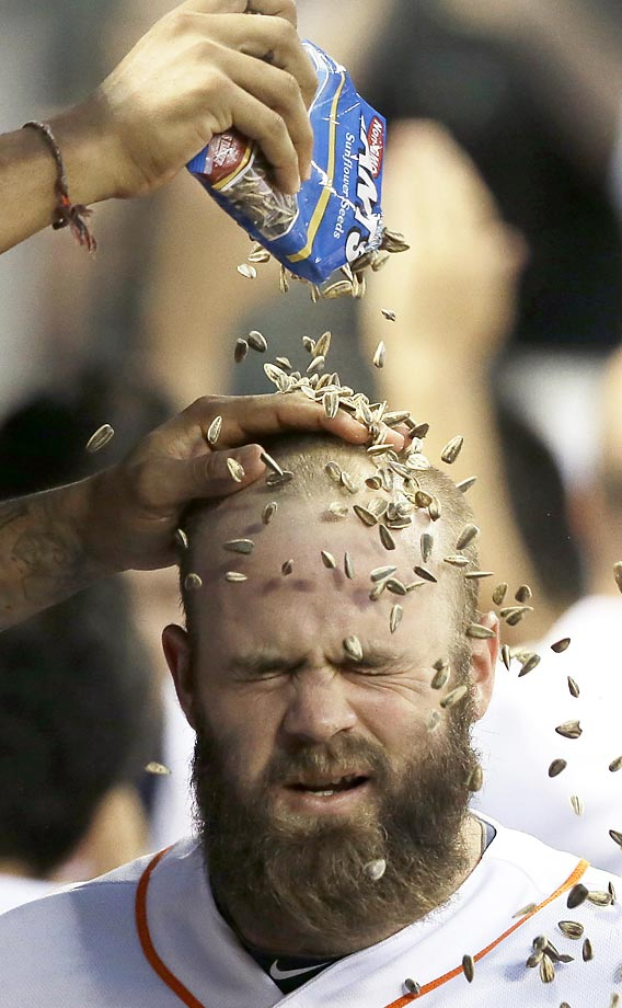 Evan Gattis of the Houston Astros is rewarded with a sunflower-seed shower for hitting a three-run home run against the Baltimore Orioles on June 2.