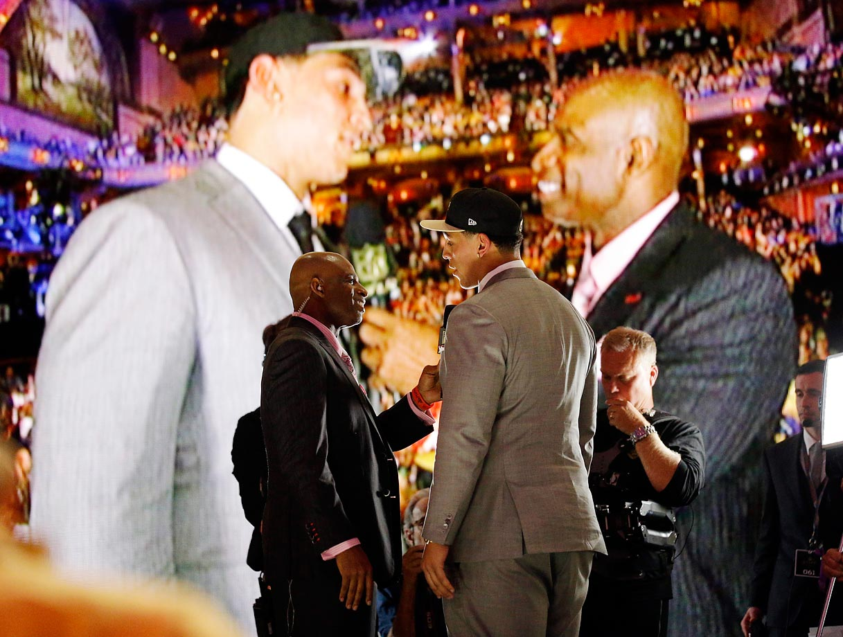 Andrus Peat of Stanford with Deion Sanders after being selected by the New Orleans Saints as the 13th pick in the NFL draft.