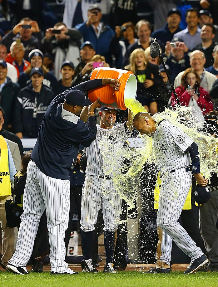 CC Sabathia and Brett Gardner dump Gatorade on Derek Jeter after he hit a game winning RBI in the ninth inning against the Baltimore Orioles.  This was his last game ever at Yankee Stadium.