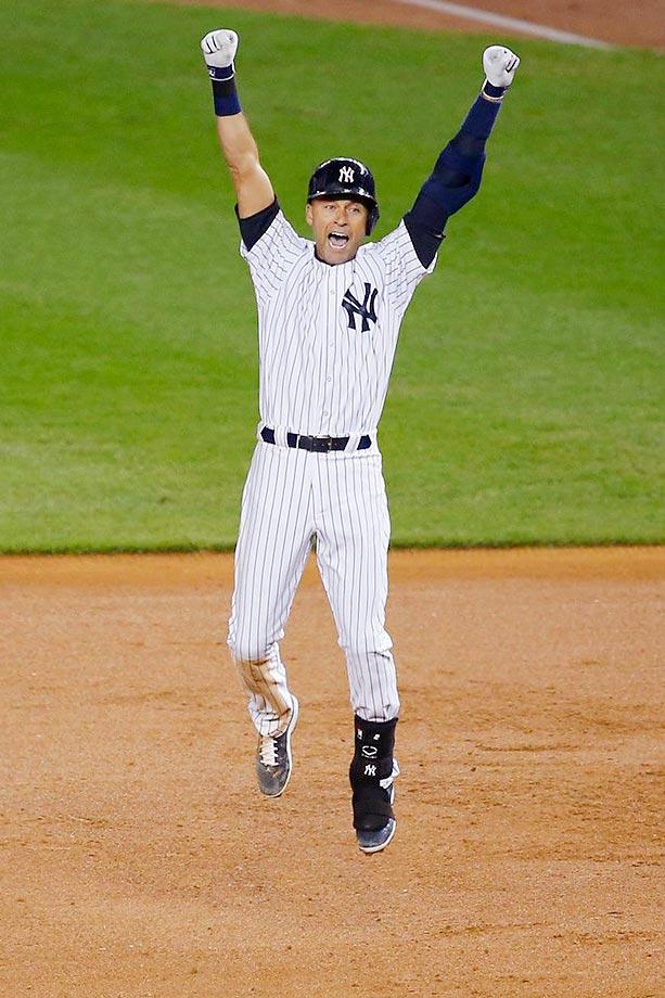 Derek Jeter celebrates his game-winning hit in his last at-bat at Yankee Stadium.