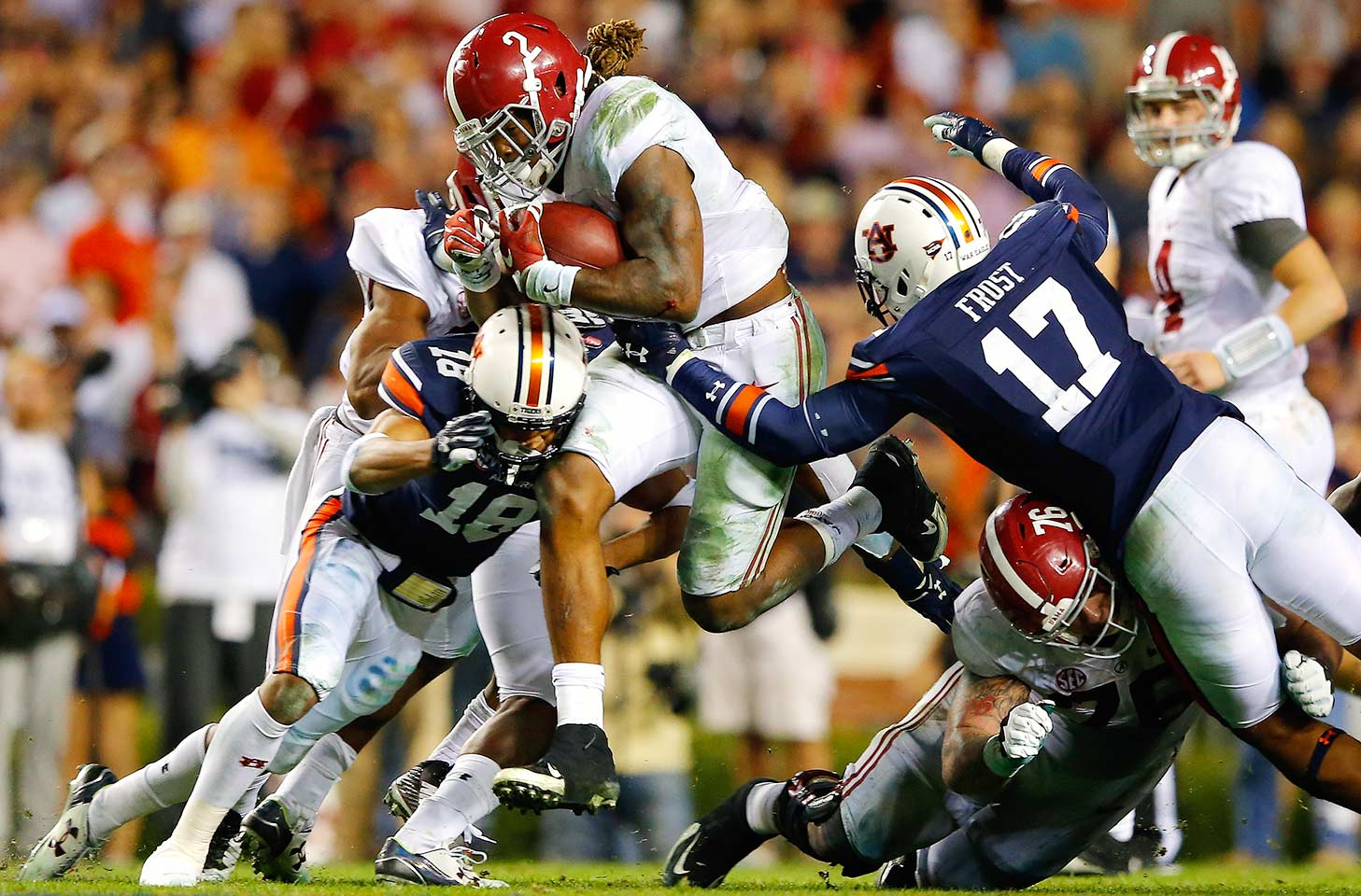 Alabama 29, Auburn 13. The Crimson Tide kept feeding Derrick Henry the rock, and he kept delivering. Henry rushed 46 times for 271 yards to propel Alabama to victory in the Iron Bowl.