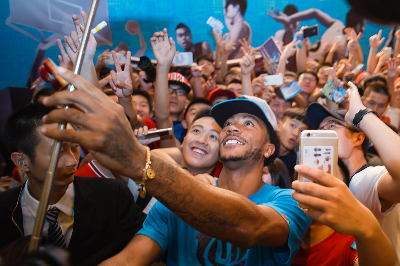 Derrick Rose takes a selfie with fans during a trip to China.