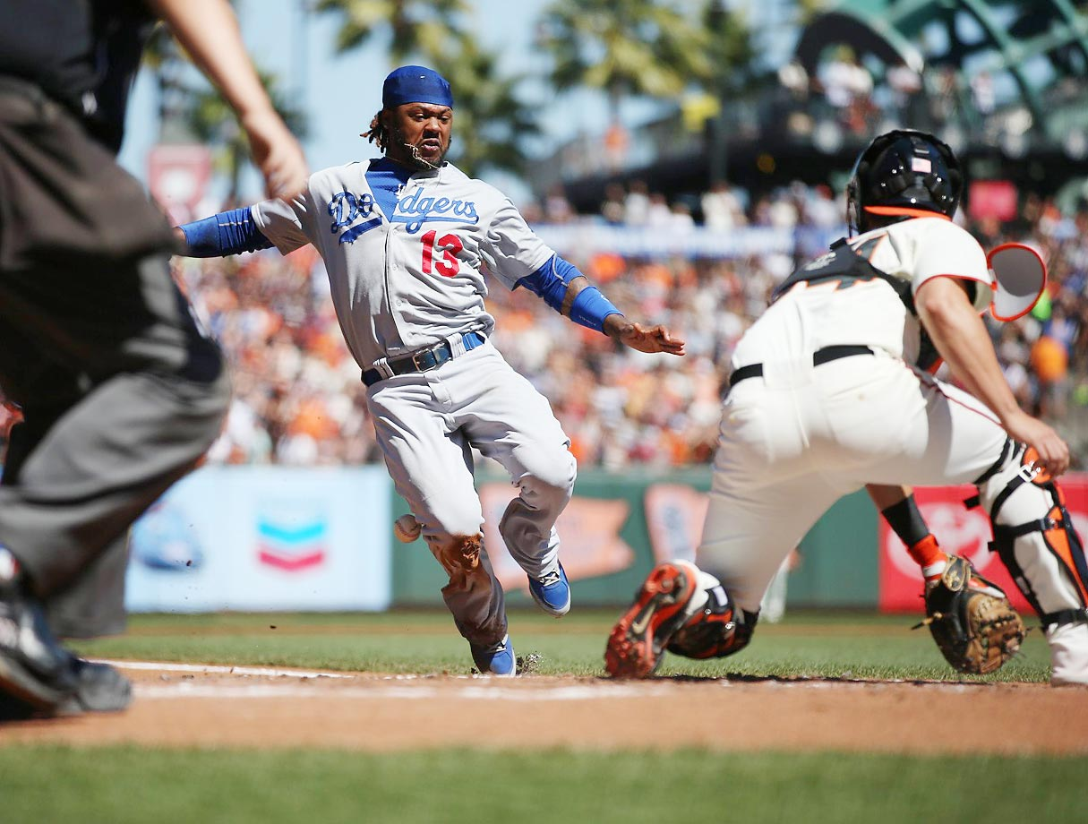 The Dodgers' Hanley Ramirez goes in to score against the Giants' Andrew Susac.