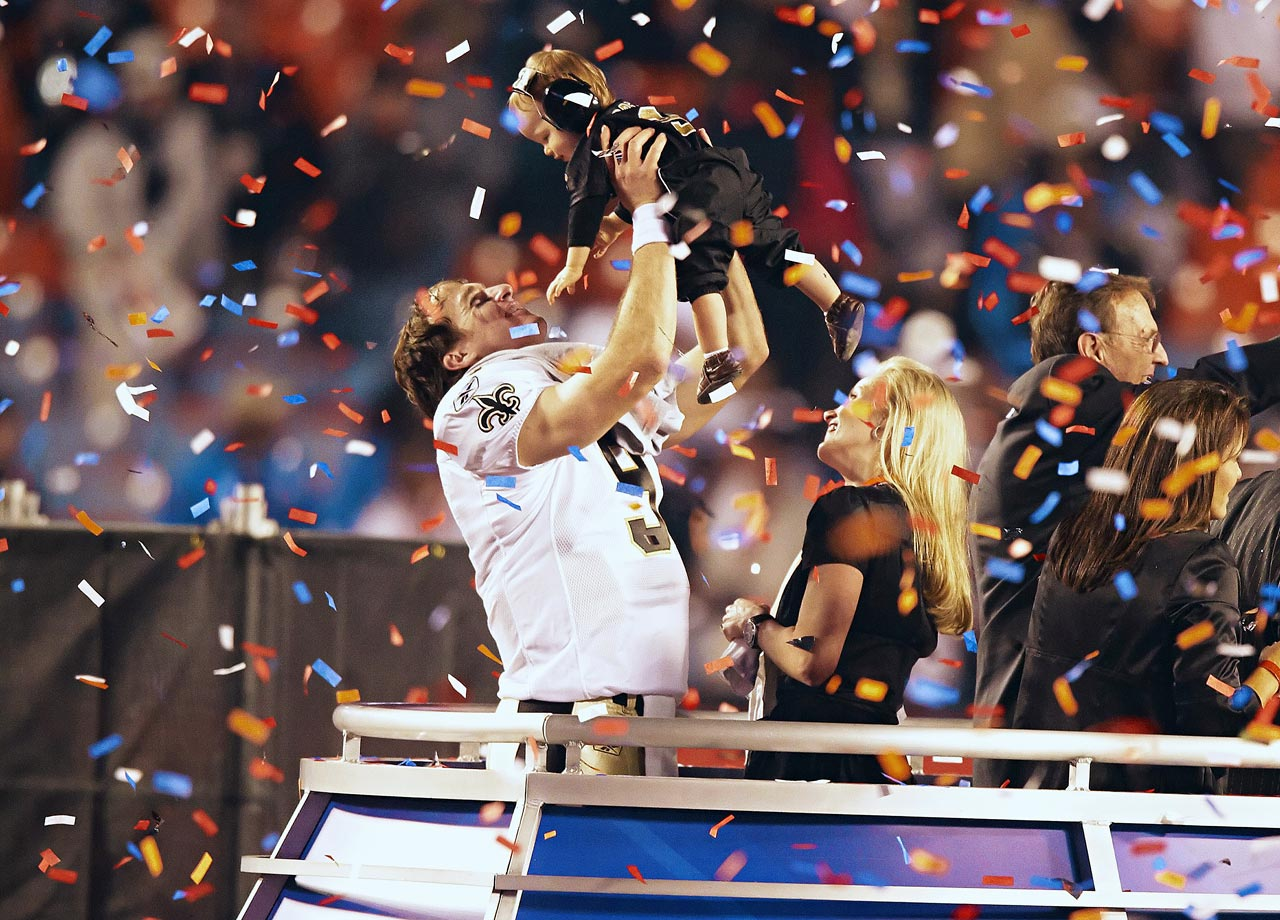Amid the falling confetti, Drew Brees hoists his son after New Orleans' 31-17 Super Bowl victory over the Colts. Brees was terrific -- completing 32-of-39 attempts for 288 yards and two touchdowns -- and was named Super Bowl MVP.