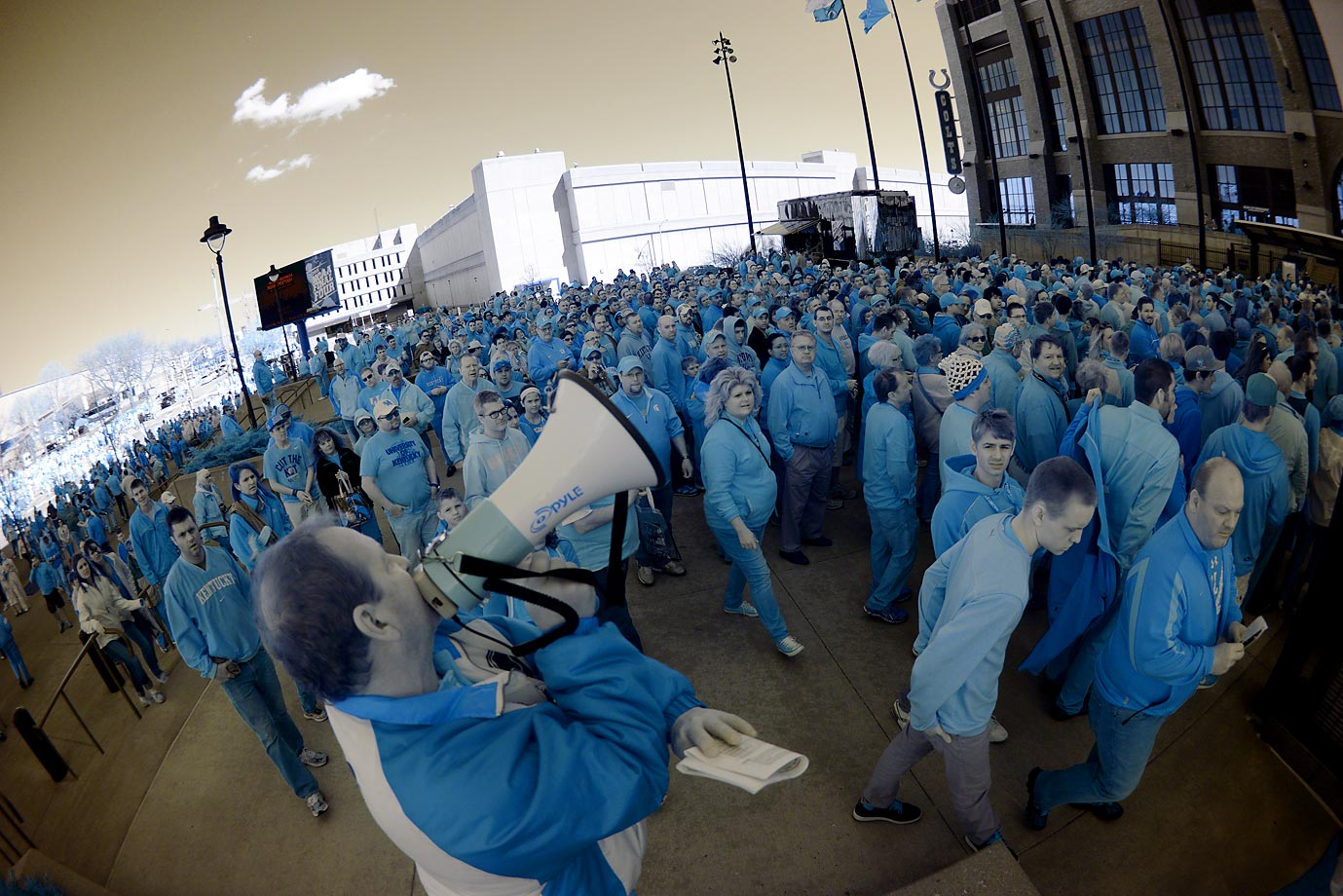 Photographer Lance King uses an infrared camera to create this image of fans outside Lucas Oil Stadium prior to the NCAA men's Final Four semifinals on Saturday.