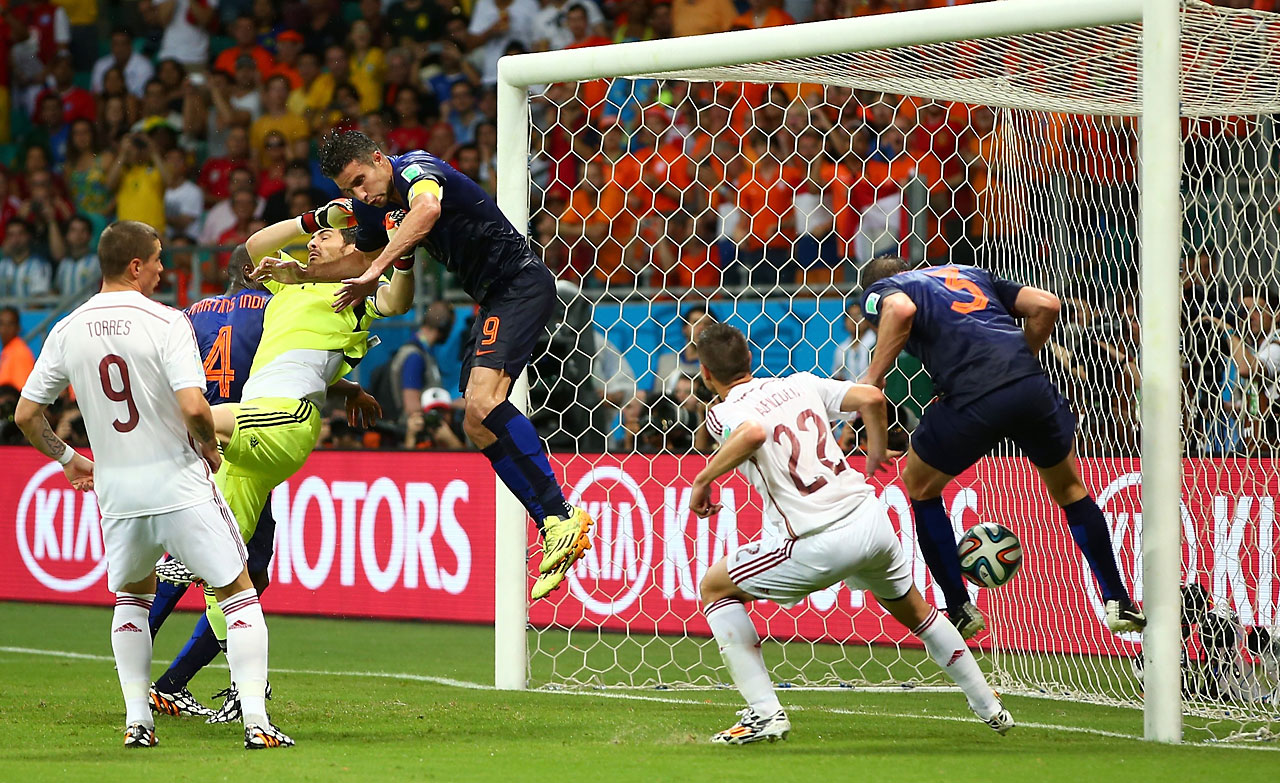 Stefan de Vrij of the Netherlands (right) scores a goal against Spain at Arena Fonte Nova on June 13.