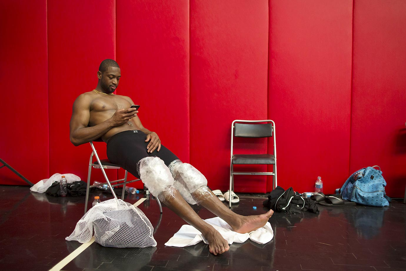 Miami Heat's Dwyane Wade icing his knees after practice in Rio de Janeiro.  The Heat played the Cavs in a preseason game on Saturday as part of the NBA Global Games.