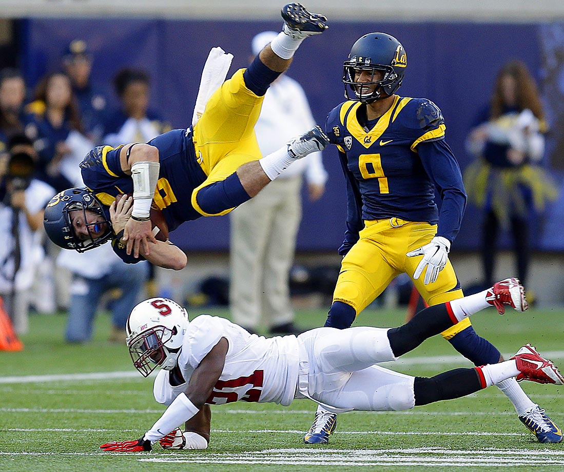 Stanford's Ronnie Harris upends Cal's quarterback Luke Rubenzer in the second half on Saturday.