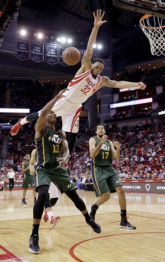 Elijah Millsap of the Utah Jazz is fouled by K.J. McDaniels of the Houston Rockets. The Rockets won 117-91.