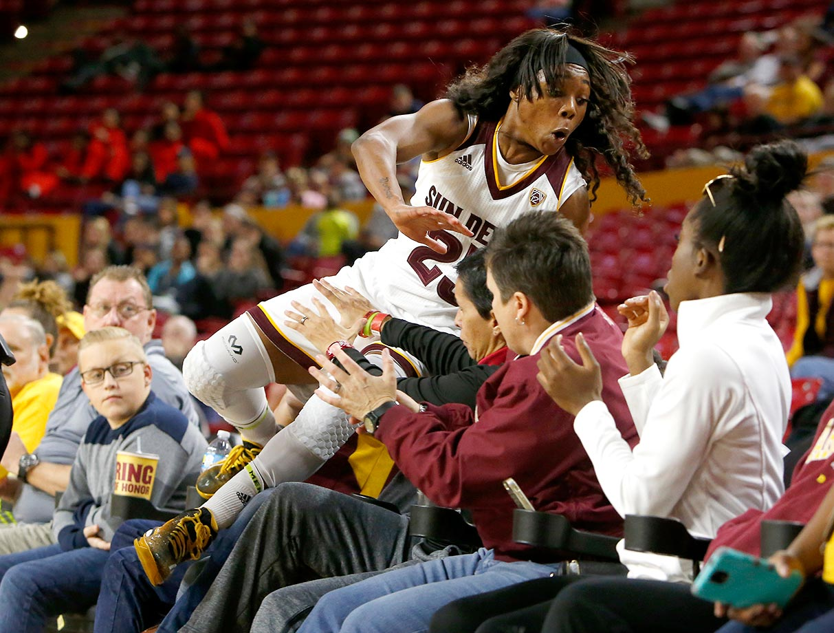 Elisha Davis of Arizona State falls into the stands while trying to save a loose ball in a game against Florida State.