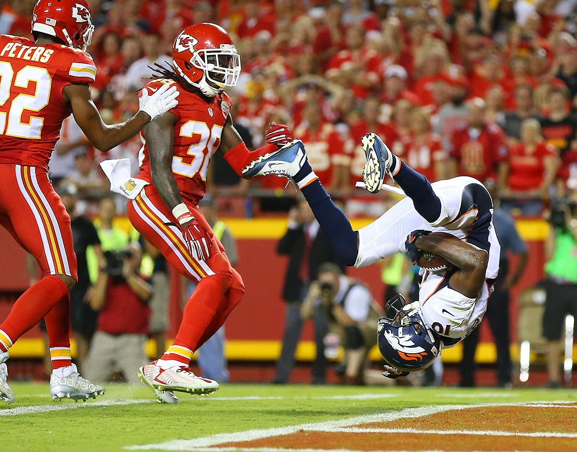 Emmanuel Sanders of the Denver Broncos summersaults into the endzone against Marcus Peters and Ron Parker of the Kansas City Chiefs.