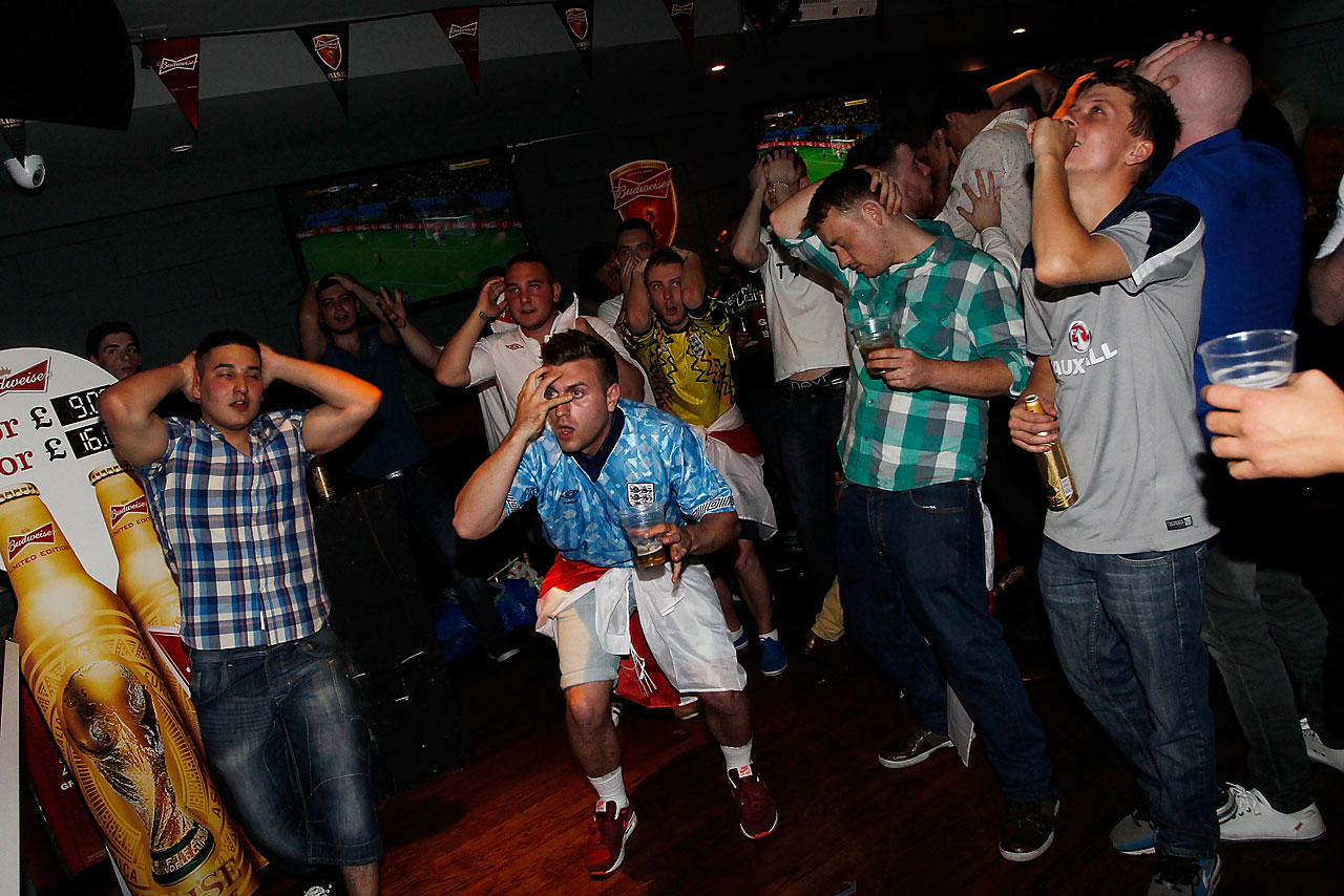 England football fans react in Riley's Sport's Bar in London as England fails to equalize against Italy in a 2-1 loss.