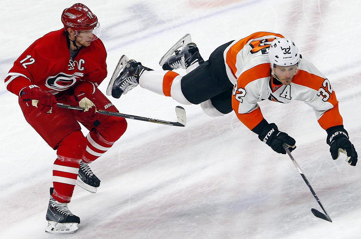 Carolina Hurricanes' Eric Staal upends Mark Streit of the Philadelphia Flyers.