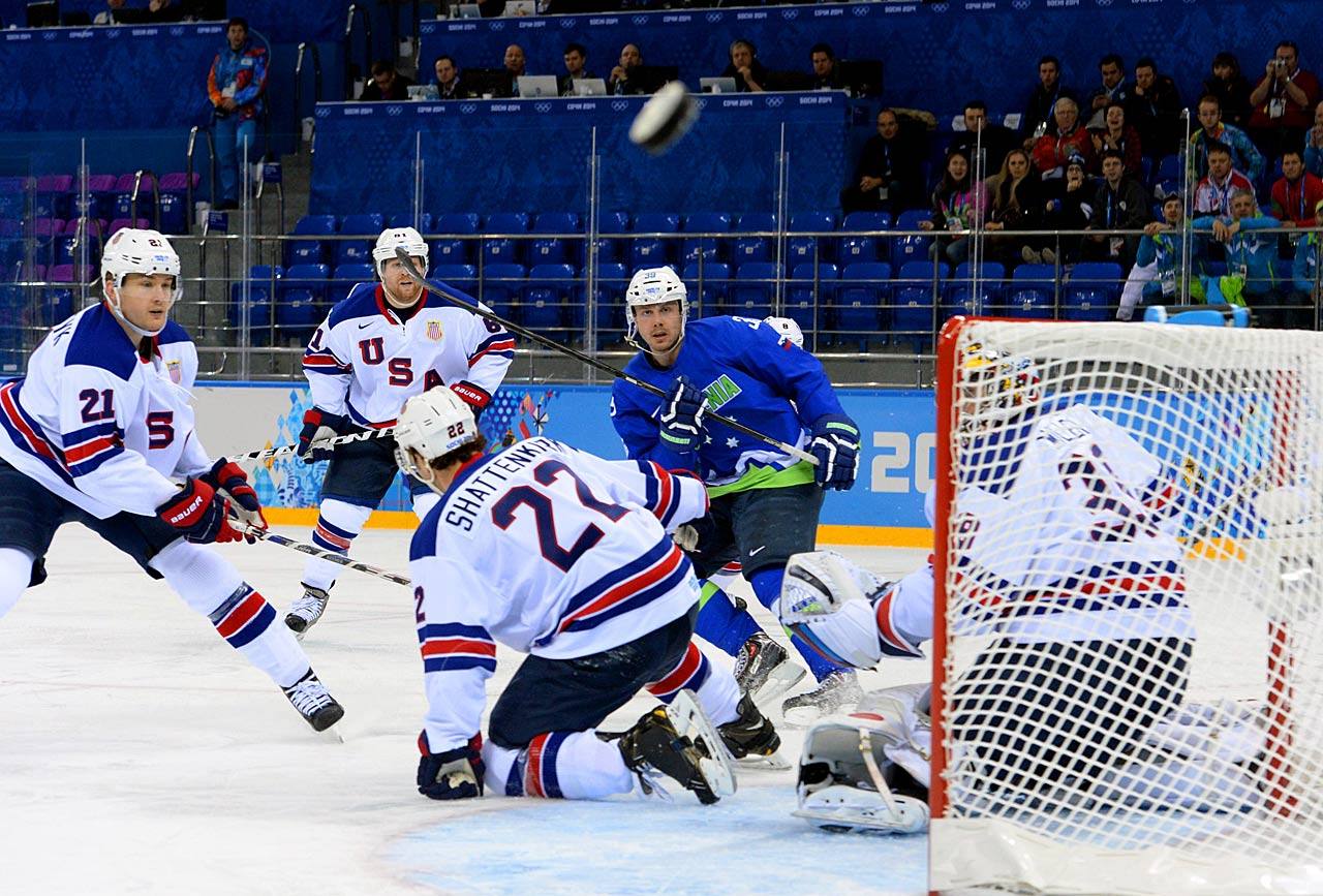 This errant shot by Jan Mursak against the U.S. sends the puck in the direction of the photographer.
