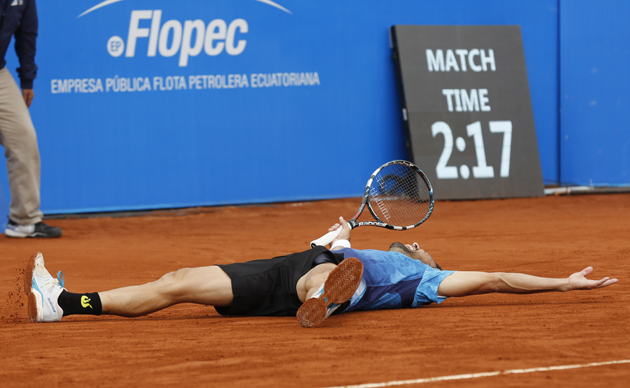 Estrella Burgos lies on the court celebrating his victory over top seed Feliciano Lopez.