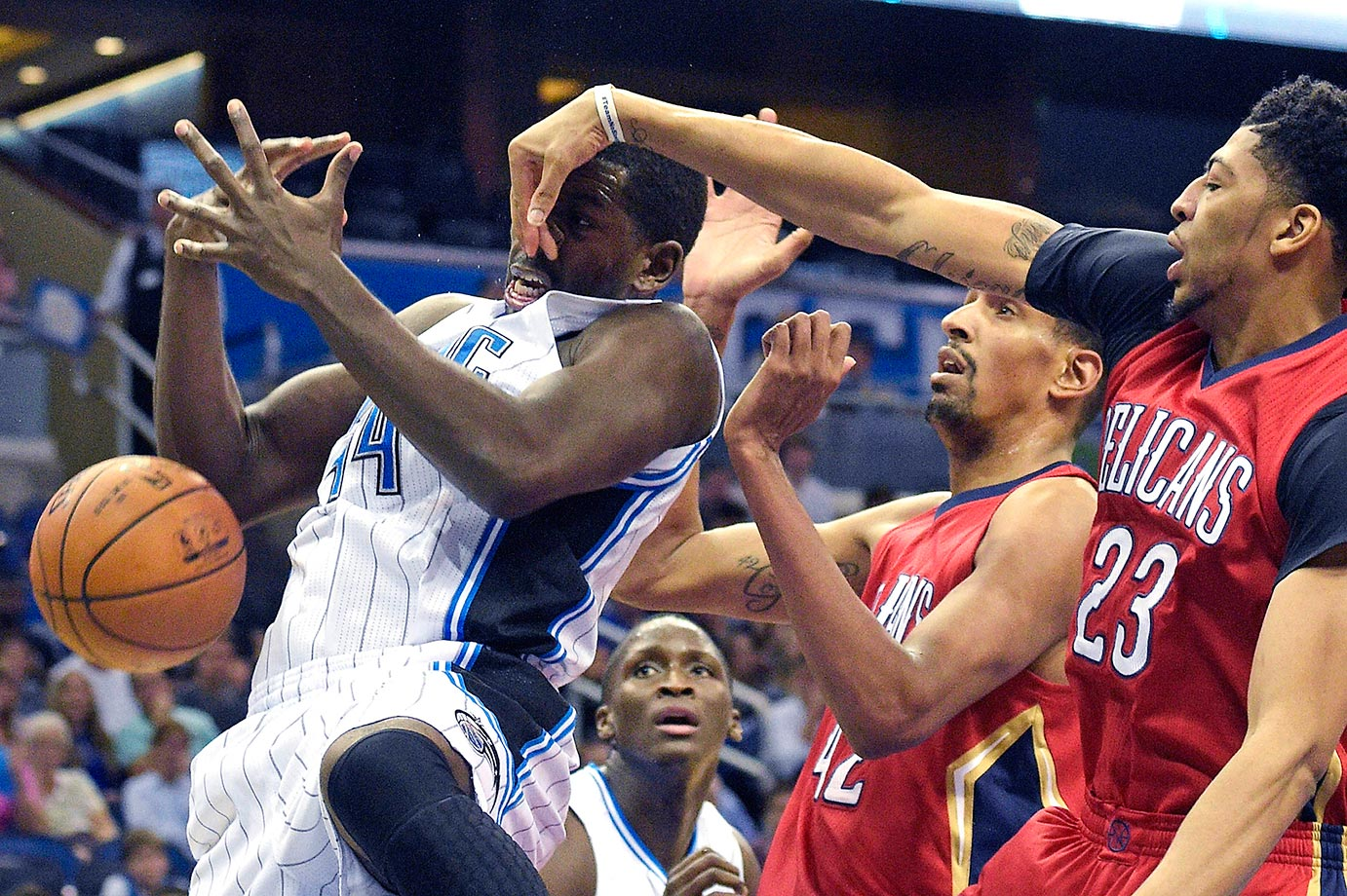 Anthony Davis of the New Orleans Pelicans blocks a shot by Andrew Nicholson of the Orlando Magic.