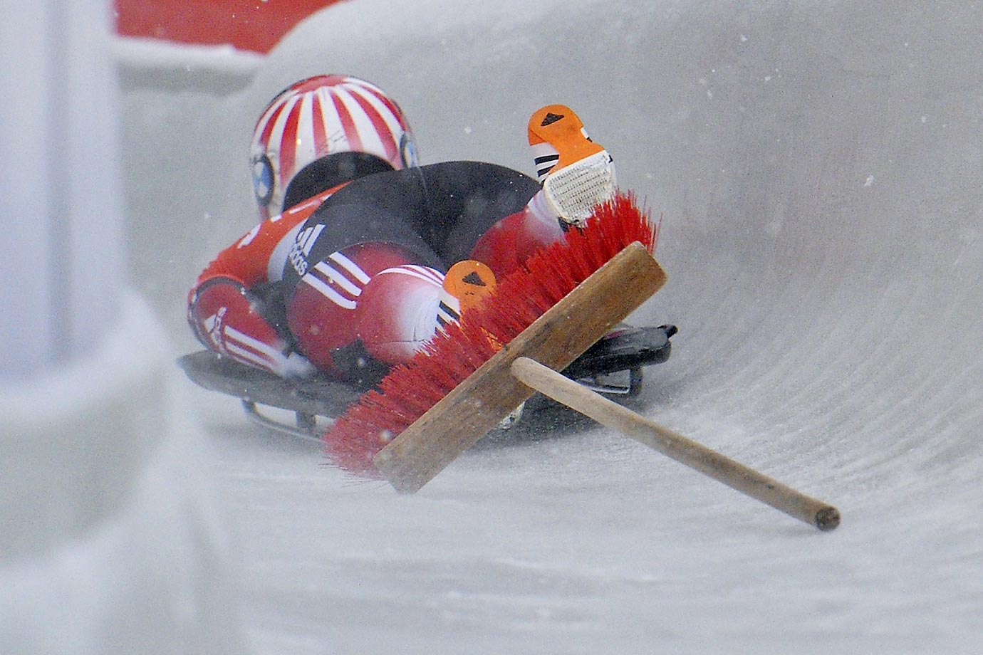 Lanette Prediger runs into a broom during her first run in the Skeleton World Cup race in Igls, near Innsbruck, Austria.