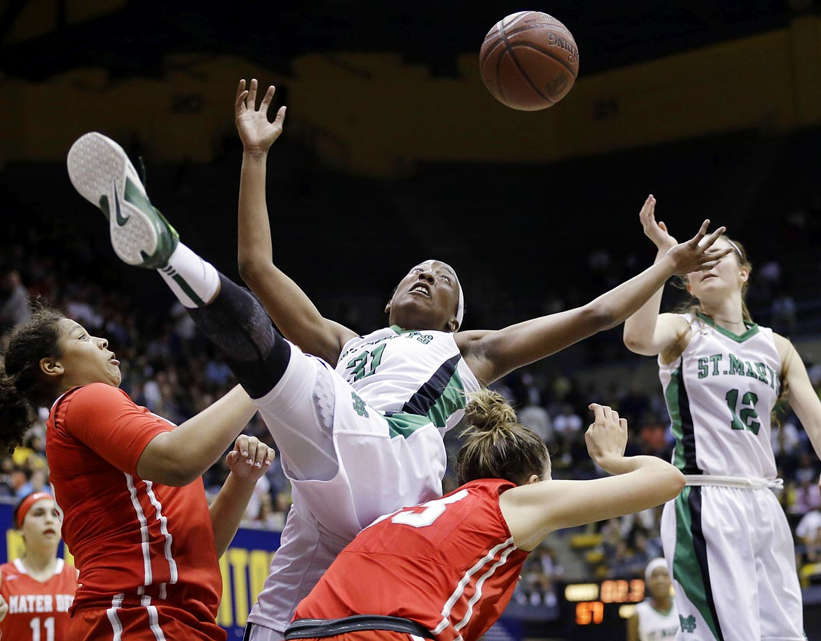 High school freshman sensation St. Mary's Aquira DeCosta flails for a loose ball against Mater Dei in the CIF Open Division state title game in Berkeley, California.