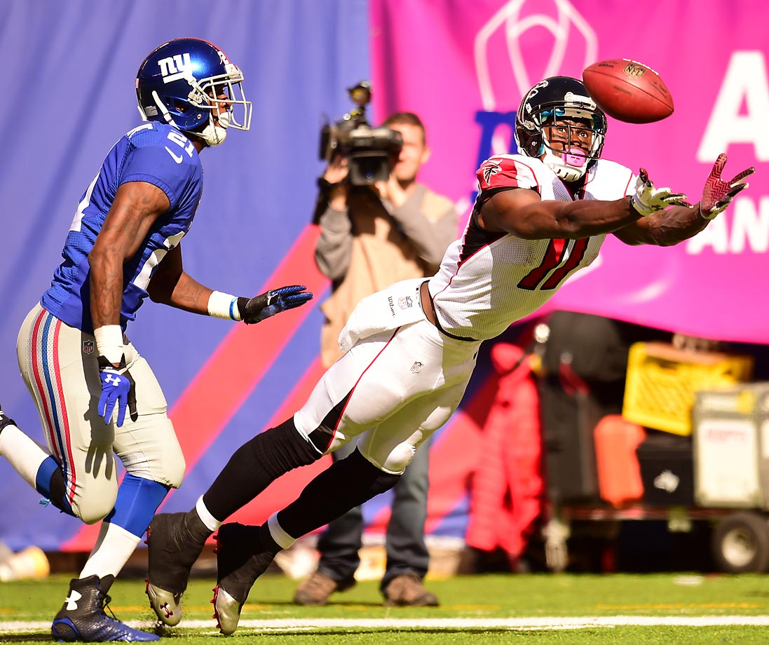 Falcons wide receiver Julio Jones reaches for the catch against Giants cornerback Dominique Rodgers-Cromartie.
