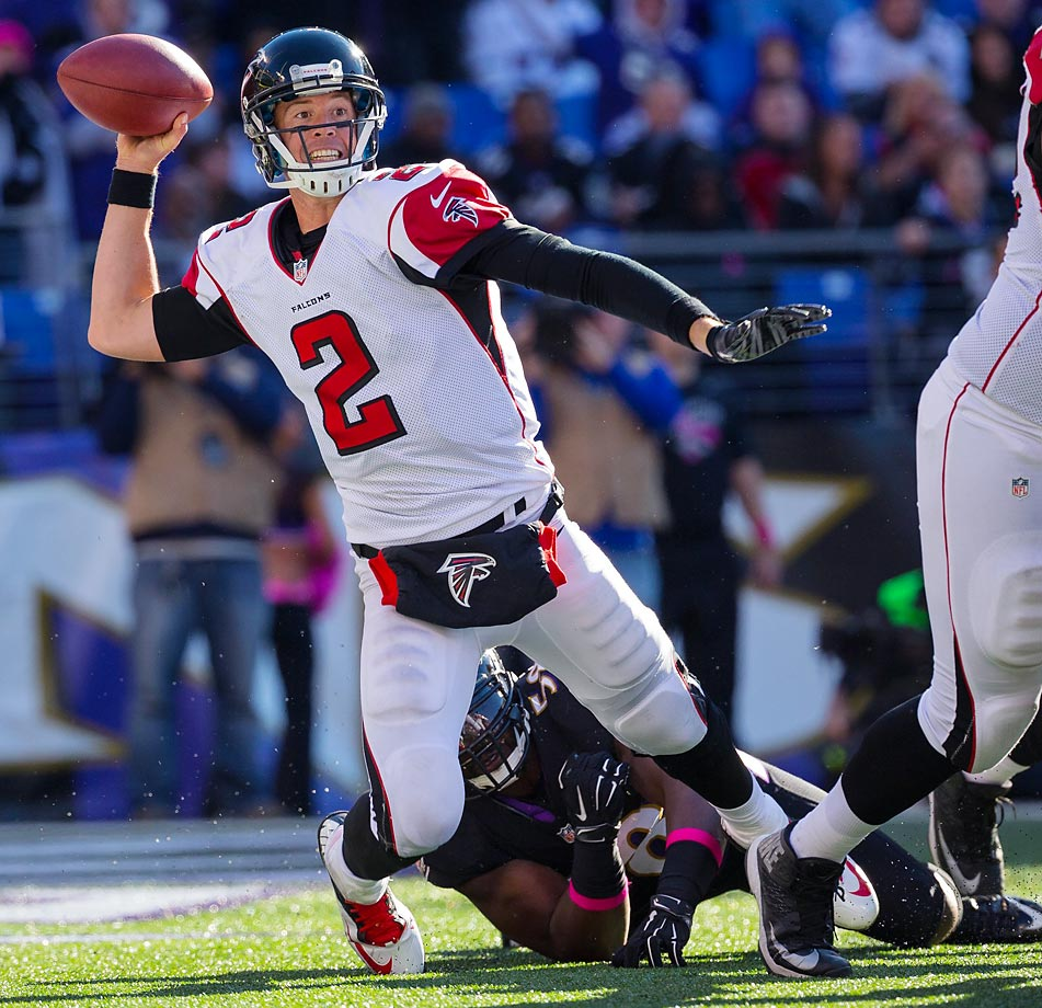 Matt Ryan avoids a safety as he gets a pass off from inside the end zone.