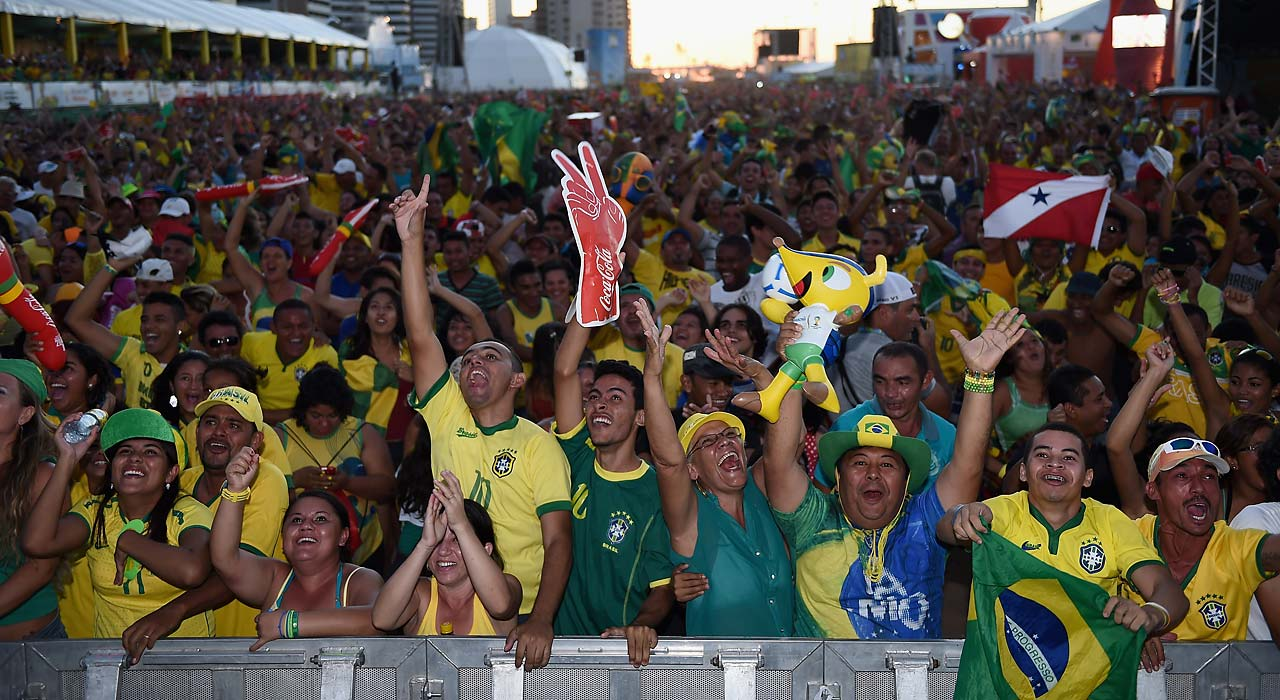 Brazil fans celebrate the first goal scored by Neymar.