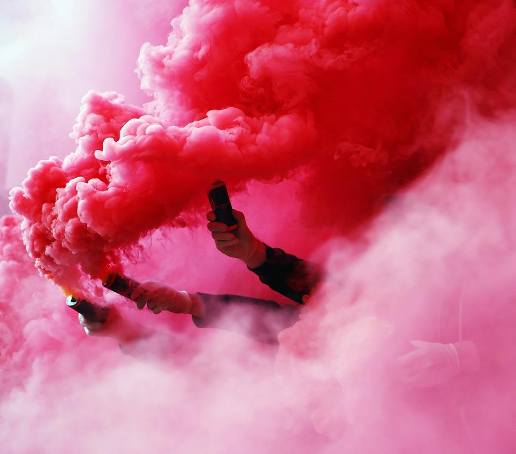 Fans of Stuttgart burn flares before the Bundesliga match between VfB Stuttgart and SV Werder Bremen at the Mercedes-Benz Arena on in Stuttgart, Germany.