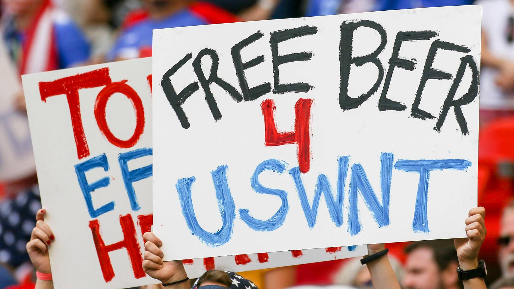 Free Beer 4 USWNT sign at the World Cup final.