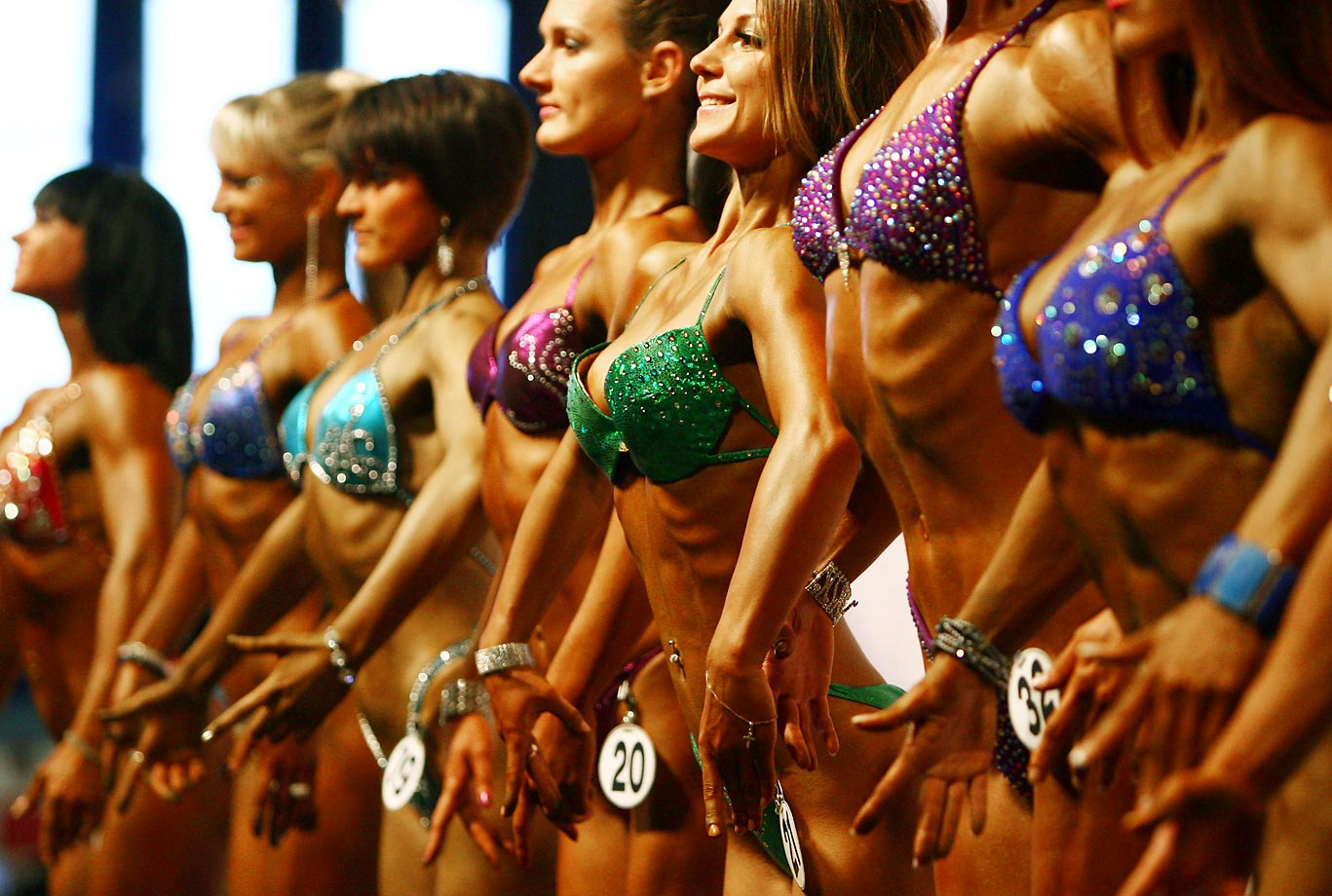 Bodybuilders flex their muscles during the Bodybuilding Championship in Belarus.