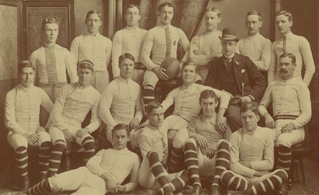 Naismith (center, far right) was a member of the football team when he attended McGill University. He is also often credited with being the inventor of the football helmet.